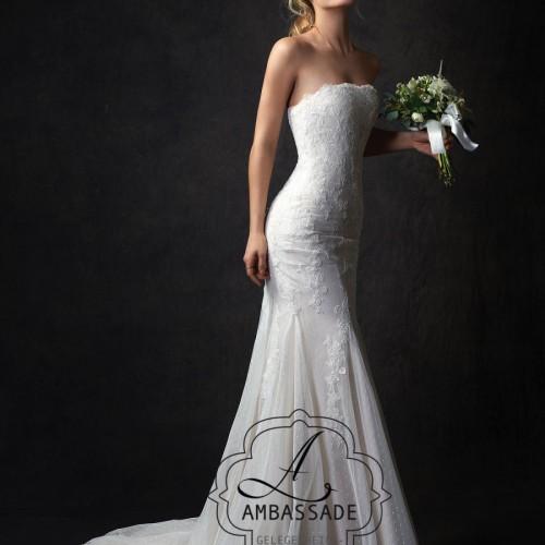 Boho bruidsjurk met verlaagde taille en wijde rok.
