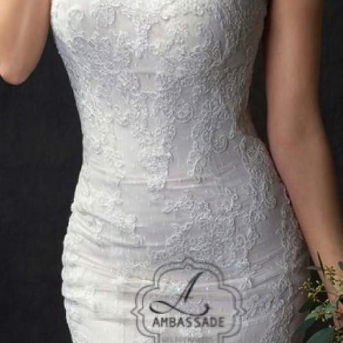 Detail van strapless Boho bruidsjurk met kant.