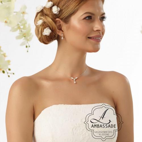 Eenvoudige curlis met roosjes voor in je bruidskapsel. Liever je jurk meenemen voor het uitzoeken van accessoires? Vraag naar de mogelijkheden voor stijladvies.